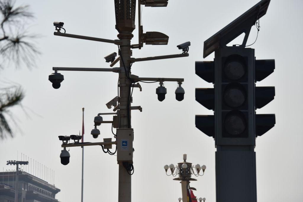 在中共的「春風化雨」背後,是廣大受迫害、受凌辱民眾的血淚。圖為2019年9月6日天安門廣場一角的監控錄像儀。 (GREG BAKER/AFP/Getty Images)