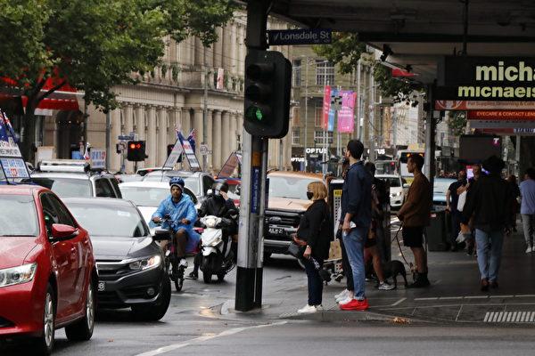 2021年1月26日,澳洲墨爾本退黨服務中心舉行「解體中共邪黨」汽車遊行活動。(李奕/大紀元)