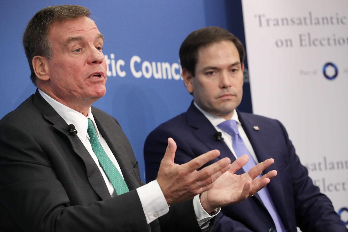 圖:2018年7月16日,美國參議院情報委員會的兩名領導人,參議員馬克·沃納(Mark Warner)和參議員馬爾科·魯比奧(Marco Rubio)在華盛頓參加大西洋理事會的討論。(Chip Somodevilla/Getty Images)