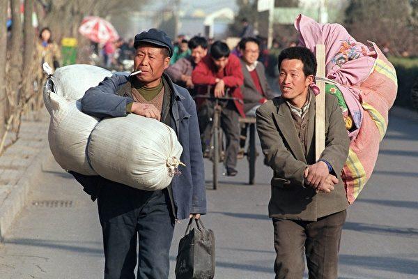 改革開放後,中國人幸福了嗎?在全球156個國家和地區中,中國的幸福指數僅排名112位,屬於相當缺乏幸福感的國家之列。(ROBYN BECK/AFP/Getty Images)