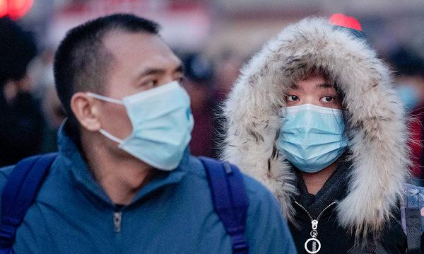 截至1月22日午夜12時,中國大陸共確診571宗中共肺炎病例,17宗死亡病例。境外共有7個國家、地區出現10個確診個案。(Kevin Frayer/Getty Images)