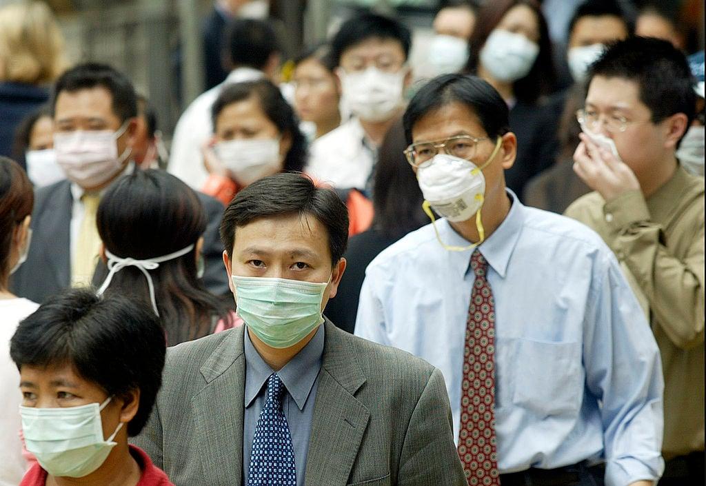 大陸網民認為中共公佈的疫情情況不符合邏輯,還有網民嘲笑:「只出國不出省,是個愛國病毒。」(PETER PARKS/AFP/GettyImages)