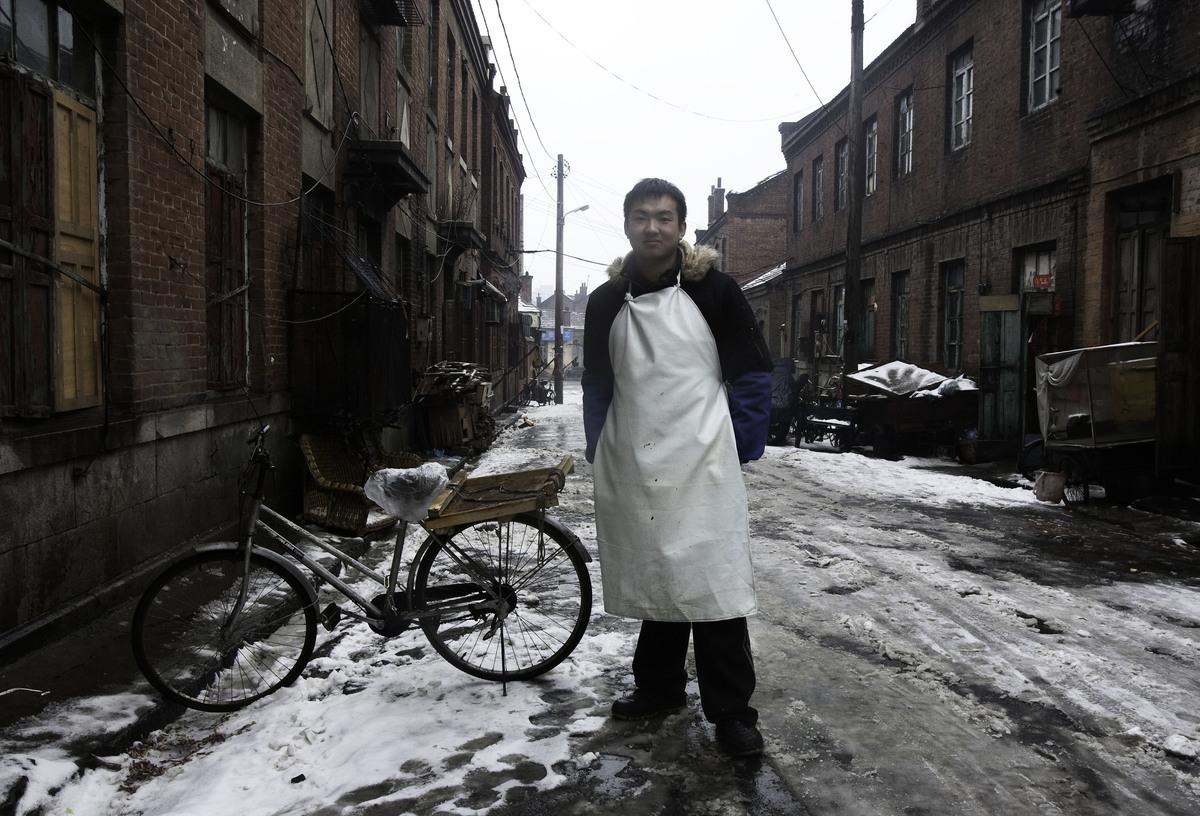 據中共人力資源和社會保障部的數據,2008年12月,中國的城鎮登記失業率攀升至4.2%,為5年來的最高水平,估計有2000萬農民工因生產出口貨物工廠停工而失業。圖為2009年2月,中國遼寧省大連市的一條街道。(China Photos / Getty Images)