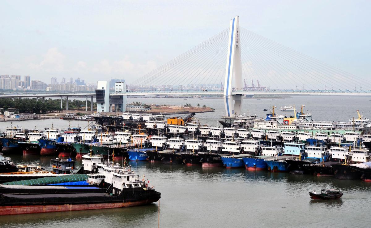 中共設想中的海南自由貿易港,最後很可能會變成一個四不像。圖為海南海口的一個漁港。(STR/AFP via Getty Images)