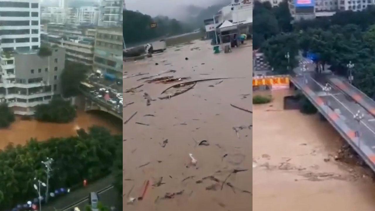 中國近日多達24省遭遇洪水侵襲,重慶綦江、江津、南川等地日前出現暴雨,橋樑被衝垮,鐵路被衝斷,整棟三層樓房被洪水沖入江中。當局卻嚴控網民言論。(影片截圖)