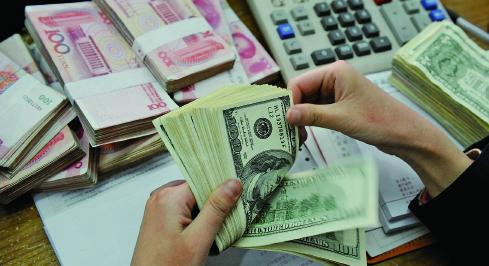 有大陸財經評論人士認為,大陸現在的外匯現金儲備已經是零了。(Photo credit should read STR/AFP/Getty Images)