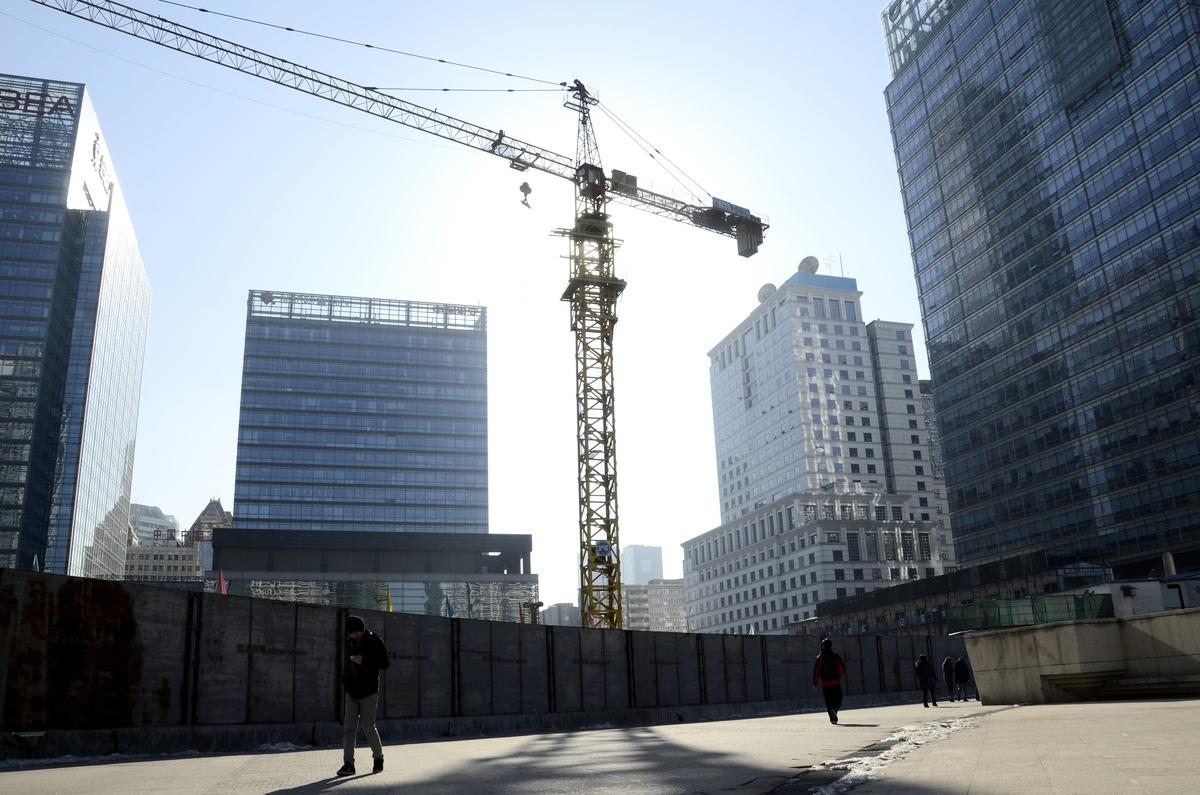中國目前存在巨額債務、違約率高等風險,中共主導經濟的發展模式已經不再奏效。圖為示意圖。(AFP)