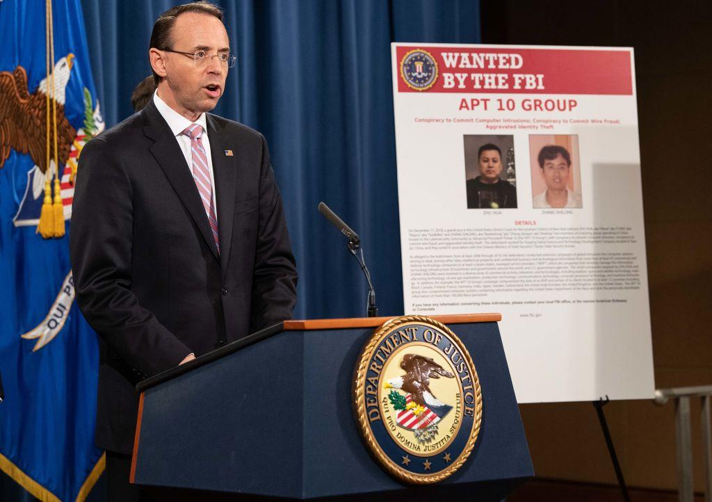 20日,美國司法部宣佈起訴中共國安部黑客組織成員朱華和張士龍。(Nicholas Kamm/AFP/Getty Images)