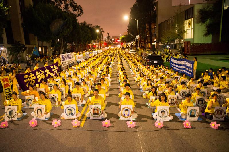 海外法輪功學員悼念在中國大陸被中共迫害致死的法輪功修煉者。(明慧網)