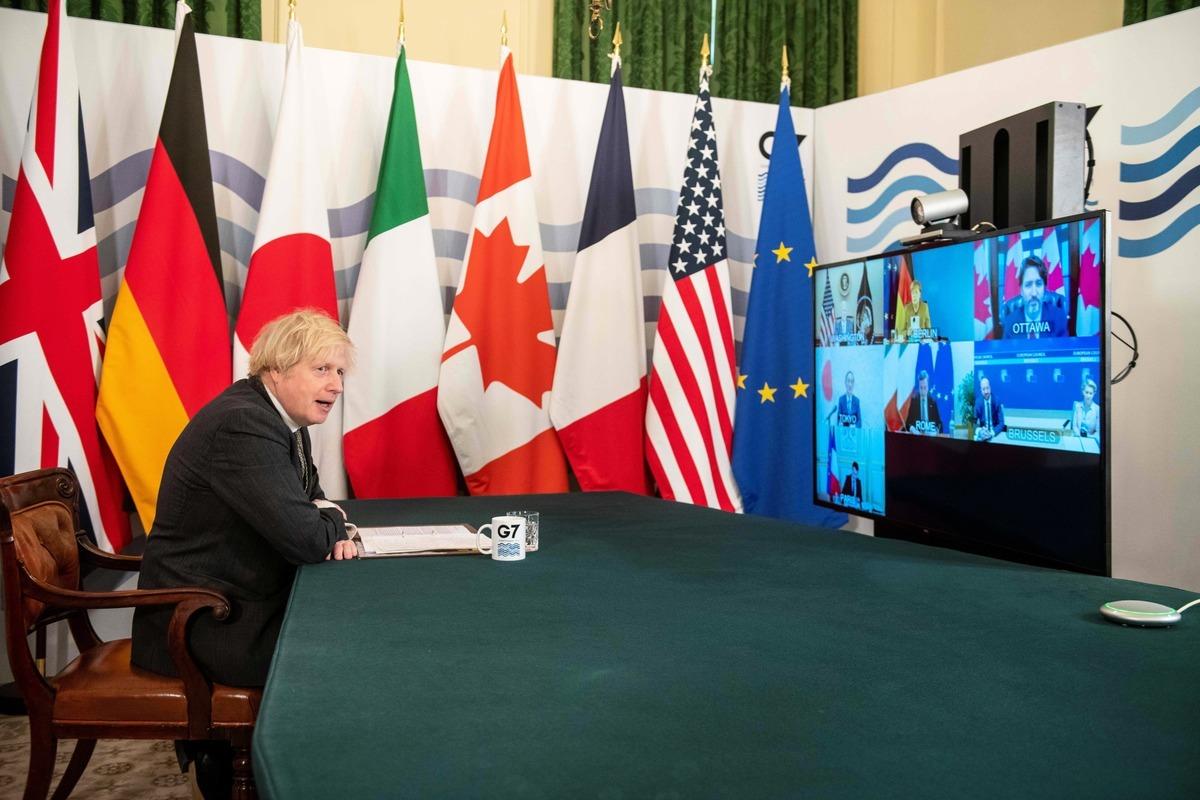 圖為英國首相鮑里斯·約翰遜(Boris Johnson)2月19日參加7國集團在線會議。(Photo by GEOFF PUGH/POOL/AFP via Getty Images)