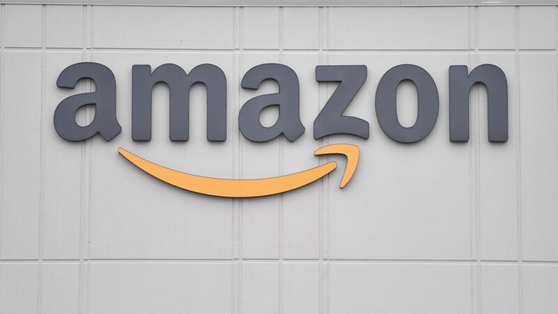 美國在線零售巨頭亞馬遜的徽標。(ANGELA WEISS/AFP via Getty Images)