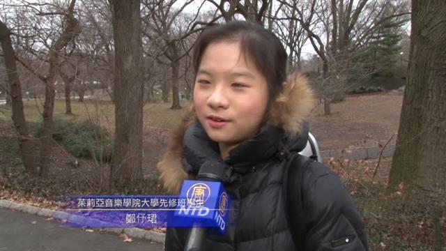 在2月6日台灣地震後,一位拉著中提琴的17歲台灣小女孩走上街頭。她利用空的琴盒當作募款箱,希望盡她微薄的力量,為家鄉臺南受災民眾募款。(影片截圖)